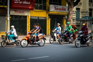 The guy in the green: motor bike ride share — hop on the back like the bear